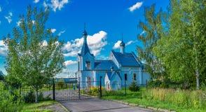 Church in the village dyachkovo Ivanovo region. Summer day, blue sky, a small village Church hid behind the trees royalty free stock photos