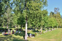 Summer day at the cemetery. A beautiful August day at Örnäskyrkogården in Lule Royalty Free Stock Images