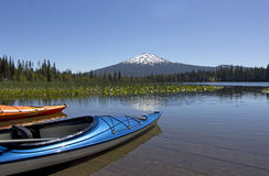 Summer Day Colorful Kayaks On Hosmer Lake Oregon Royalty Free Stock Image