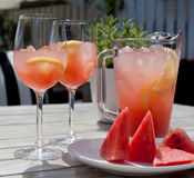 Summer day. Fruit Lemonade with glasses, pitcher, watermelon slices on the wooden table. Stock Image