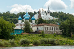 Summer day in Gorokhovets. River bank Klyazma. Gorokhovets, Vladimir region. The monastery Svyato-Troitse-Nikolsky on the Puzhalova mountain and Annunciation Stock Photo