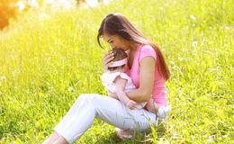 Summer day, happy mother and child outdoors Stock Photography