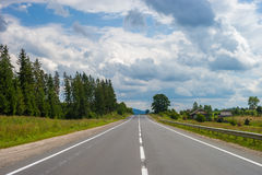 Summer day landscape with forest, cloudy sky and road. Carpathian mountains Royalty Free Stock Photography