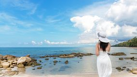 Summer Day. Lifestyle woman wearing white dress fashion summer beach on the sandy ocean beach. stock photo