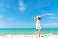 Summer Day. Lifestyle  woman wearing white dress fashion summer beach  on the sandy ocean beach. Happy woman enjoy and relax vacat royalty free stock photography
