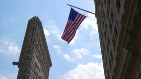 Summer day light new york city flat iron bulding american flag waving 4k usa stock footage