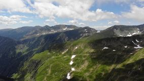 View over the Fagaras Mountains. With fluffy clouds stock video footage