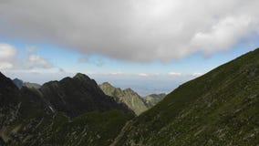 Transylvanian Plateau view. Over the Fagaras Mountains coast - Romania stock video footage