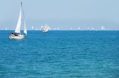 Summer day sailing a boat Royalty Free Stock Images