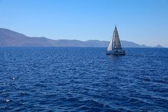 Summer day sailing boat cruising in Saronic Gulf, Greece. Horizontal royalty free stock photography