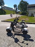 Rental electric scooters waiting at park royalty free stock photo