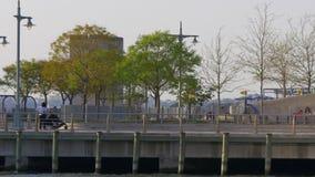 Summer day sunset light new york city east river pier 4k usa stock footage