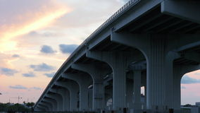 Summer day sunset sky running from under the bridge view 4k time lapse usa. Usa summer day sunset sky running from under the bridge view 4k time lapse stock video footage