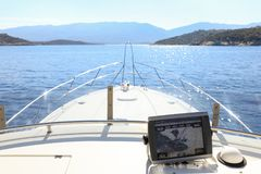 Summer day traveling by the yacht from Athens to Poros island, Greece. Horizontal Stock Images