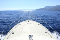 Summer day traveling by the yacht near the Poros island, Greece. Horizontal Stock Images