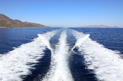 Summer day traveling by the yacht near the Poros island, Greece. Horizontal Stock Photo