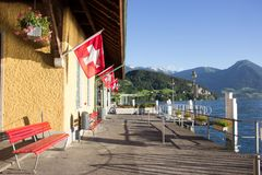Summer day view of the Vitznau boat pier on Lake Lucerne, Lucerne, Switzerland. Swiss Pass passenger can go up to Rigi Kulm. By cogwheel from Vitznau or Weggis royalty free stock photo