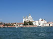Summer day view from the water to the Venetian lagoon with the Basilica of Santa Maria della Salute in Venice, Italy.  royalty free stock image