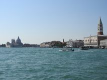 Summer day view from the water to the Venetian lagoon with the Basilica of Santa Maria della Salute in Venice, Italy.  stock photography