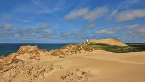 Summer day at the west coast of Denmark. 90 meter high sand dune Rubjerg Knude. Stock Photography