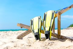 Summer Day. Yellow diving fins laying on the beach, stock image