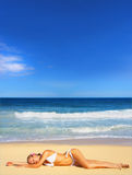 Summer Days. Bright photo of a beautiful model relaxing on a beach in Hawaii. Room for text Stock Photos