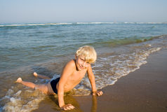 Summer days. Little boy on the beach Royalty Free Stock Image