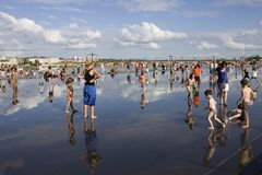 Summer days. BORDEAUX, FRANCE: Bordeaux water mirror full of people in one of the hotest summer days, having fun in the water, in Bordeaux, France royalty free stock photos