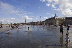 Summer days. BORDEAUX, FRANCE: Bordeaux water mirror full of people in one of the hotest summer days, having fun in the water, in Bordeaux, France stock photos
