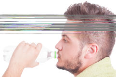 Summer dehydration concept with man drinking water Royalty Free Stock Photo