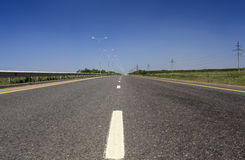 Summer deserted road. Royalty Free Stock Photos