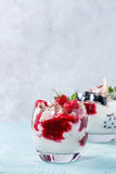 Summer dessert Eton Mess. Traditional summer dessert Eton Mess. Broken meringue with whipped cream, berry jam, fresh blueberries and raspberries in two glasses Stock Images