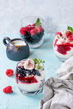 Summer dessert Eton Mess. Traditional summer dessert Eton Mess. Broken meringue with whipped cream, berry jam, fresh blueberries and raspberries in two glasses Stock Photo