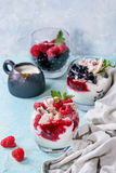 Summer dessert Eton Mess. Traditional summer dessert Eton Mess. Broken meringue with whipped cream, berry jam, fresh blueberries and raspberries in two glasses Royalty Free Stock Image