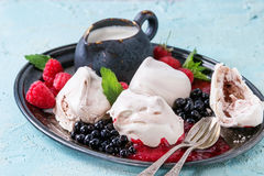 Summer dessert Eton Mess. Traditional summer dessert Eton Mess. Meringue, jug of cream, berry jam, fresh blueberries, raspberries on vintage tray, decorated with Stock Photos