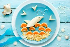 Summer dessert with fruit. And corn flakes shaped dolphin Royalty Free Stock Photography