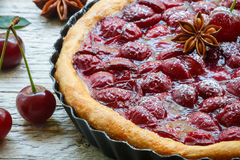 Summer dessert. Homemade cherry pie,  tart   with powdered sugar and star anise Stock Images