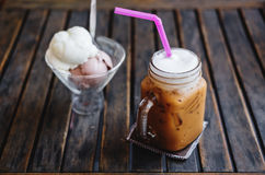 Summer Dessert, Iced Coffee with Ice Creams on wooden table, selective focus on Coffee Cup Stock Images