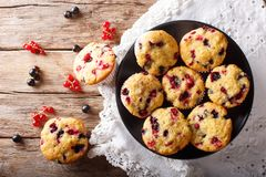 Summer dessert: muffins with a berry mix of currants close-up. H stock photography