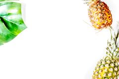 Summer dessert with pineapples and plant on white background top Stock Photo