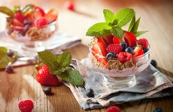 Summer dessert with strawberries on a wooden background. stock photo