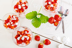 Summer dessert: strawberry with yoghurt cream and meringue in gl Stock Image