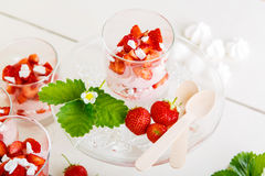 Summer dessert: strawberry with yoghurt cream and meringue in gl Stock Images