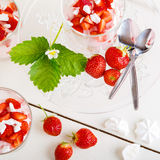 Summer dessert: strawberry with yoghurt cream and meringue in gl Royalty Free Stock Photography