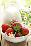 Summer dessert -  sweet strawberries and milk Stock Photography