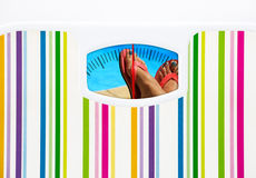 Summer diet concept with bathroom scale and swimming pool Stock Photos