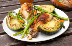 Summer dinner outside with grilled chicken and vegetables Stock Image