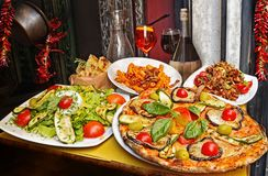 Pasta , pizza  and homemade food arrangement  in a restaurant  Rome Stock Image