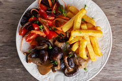 Summer dish with fried chips, tomatoe salad, grilled wild mushrooms Royalty Free Stock Photo