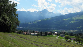 It is summer in the Domleschg Valley near the village of Almens (Switzerland). It is summer in the Domleschg Valley near the village of Almens. The Domleschg is Stock Photo